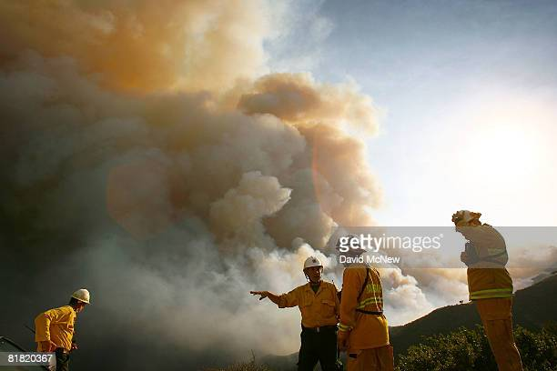 Firefighters survey the Gap fire as more than 1000 wildfires continue burning across about 680 square miles of central and northern California on...