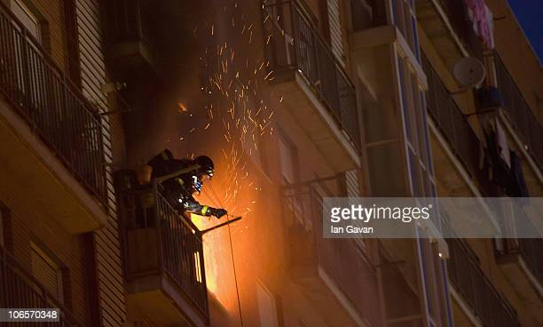 Firefighters tackle a blaze in an apartment block on Camino De Perales opposite the Caja Magica Arena on November 5 2010 in Madrid Spain The Caja...