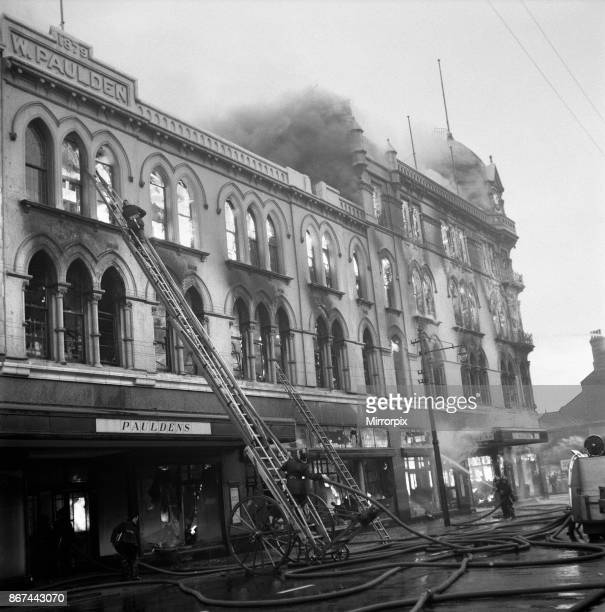 Firefighters tackle the blaze at Pauldens Department Store in Manchester which broke out shortly before the store was reopened following renovation...