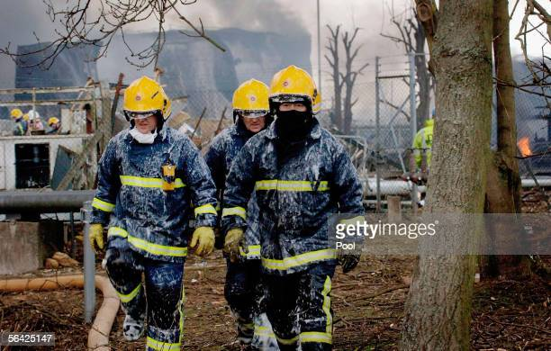 Firefighters take a break after tackling the blaze at the Buncefield oil depot as the fires continue to burn for a third day on December 13 2005 in...