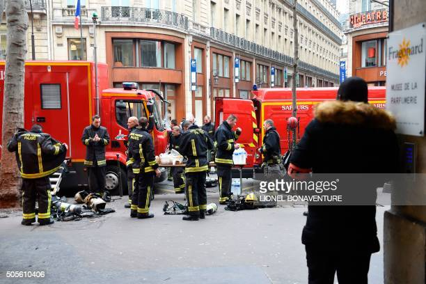 Firefighters take a break outside the Ritz Hotel after a fire erupted at the landmark hotel in Paris on January 19 2016 A major fire broke out at the...