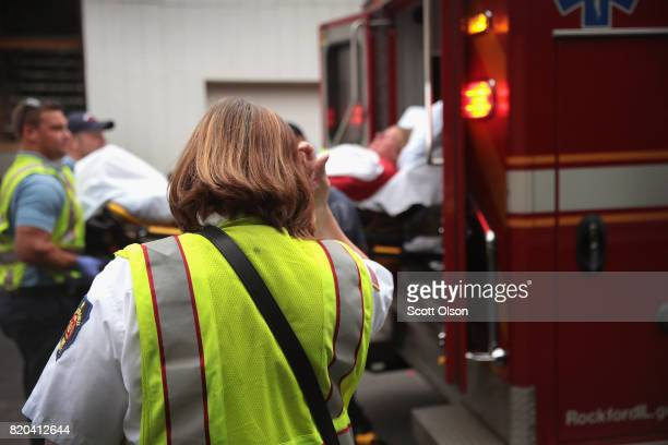 Firefighters transport an overdose victim to a hospital on July 14 2017 in Rockford Illinois The woman was found on the floor of the hotel room where...