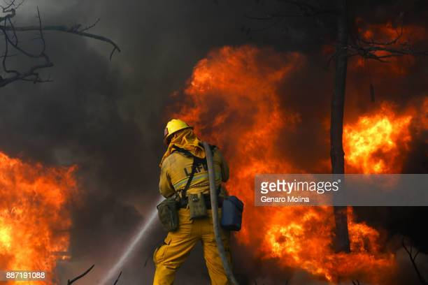 Firefighters try and save a home along Linda Flora Dr in Bel Air where the Skirball fire prompted a full closure of the 405 Freeway as well as...