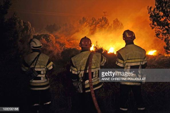 Firefighters try to control a forest fire on July 25 2010 in SaussetlesPins near the southeastern French city of Marseille Firefighters said about...