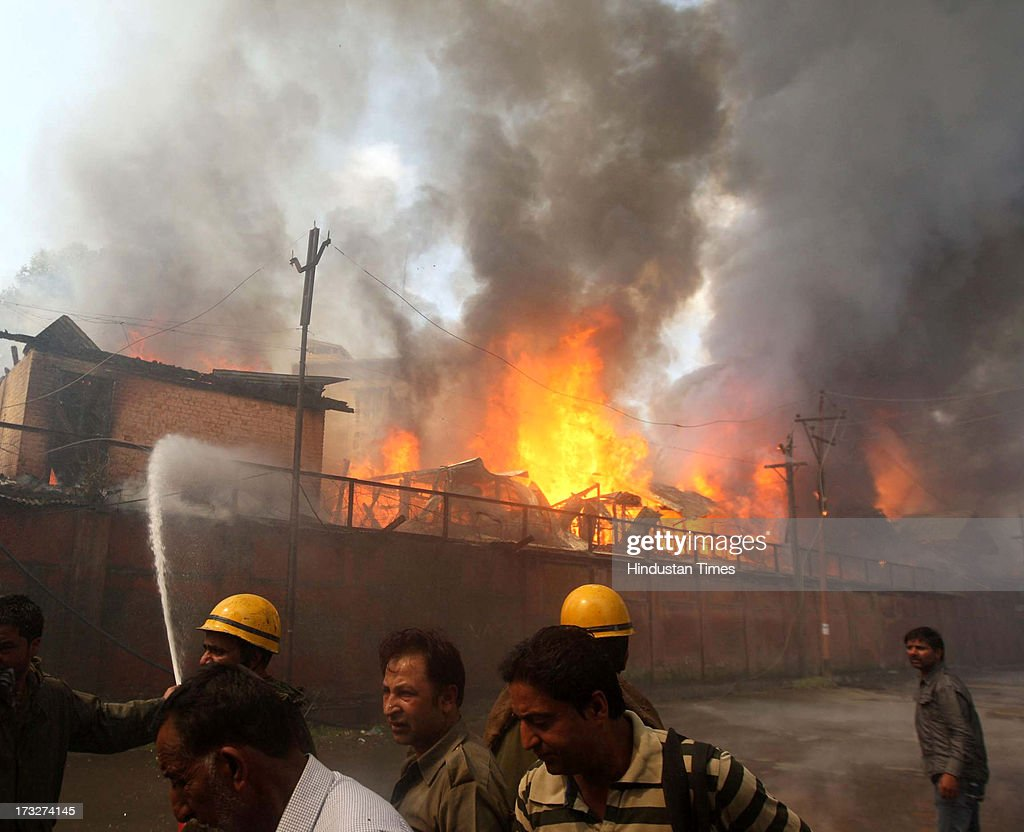 Firefighters try to extinguish a fire at a government office building on July 11, 2013 in Srinagar, India. The fire broke out in a building on the premises of the Civil Secretariat, seat of the government of Jammu and Kashmir.