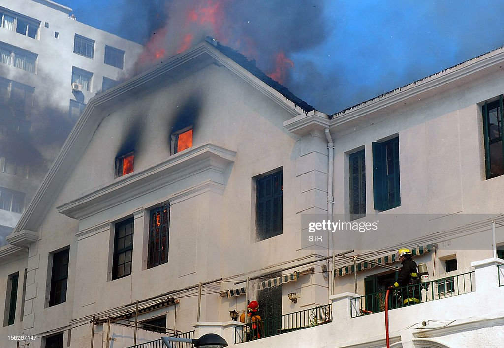 Firefighters try to extinguish a fire at the emblematic Biarritz building in Punta del Este, 140 km east of Montevideo, on November 12, 2012. The Biarritz, built in 1907, was one of the first hotels and buildings of the famous seaside resort. AFP PHOTO URUGUAY OUT