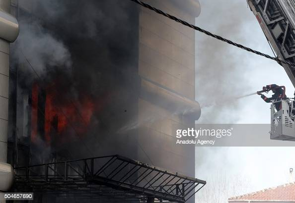 Firefighters try to extinguish a fire erupted at a hotel in Istanbul's Maltepe district on January 12 2016