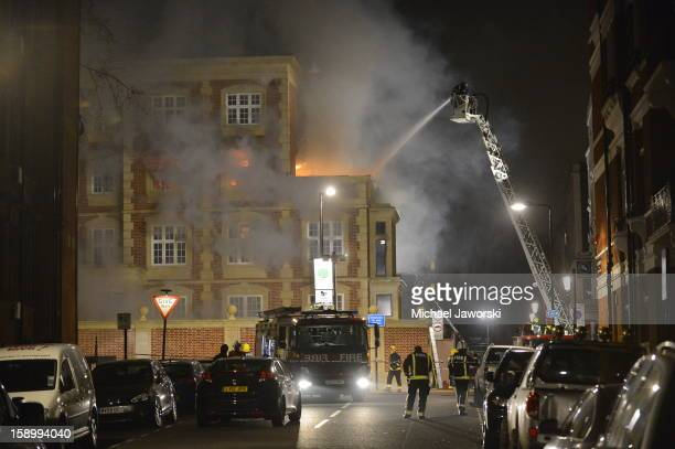 Firefighters try to extinguish a fire which has been ablaze since around midnight from a building under renovation in Moscow Road Notting Hill on...