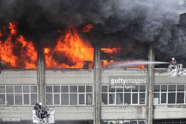 Firefighters try to extinguish fire at 3storey office in Istanbul's Bayrampasa Turkey on November 22 2016