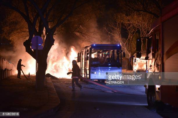TOPSHOT Firefighters try to extinguish flames following an explosion after an attack targeted a convoy of military service vehicles in Ankara on...