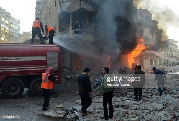 Firefighters try to extinguish the fire at the impact site after Assad Regime's airstrike over civilians in residential areas of Ariha town of Idlib...