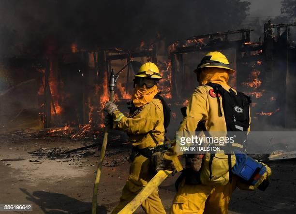 Firefighters try to save a house during the Thomas wildfire in Ventura California on December 5 2017 Firefighters battled a windwhipped brush fire in...