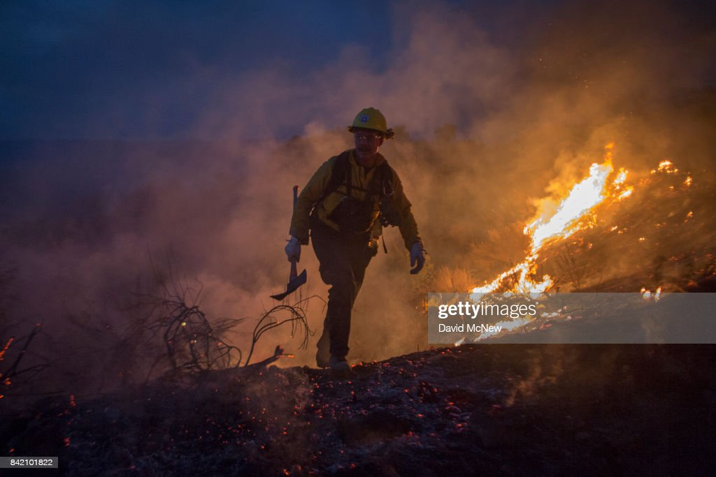 Firefighters use hand tools in chaparral brush to fight the La Tuna Fire on September 2, 2017 near Burbank, California. Los Angeles Mayor Eric Garcetti said at a news conference that officials believe the fire, which is at 5,000 acres and growing, is the largest fire ever in L.A. People have been evacuated from hundreds of homes in Sun Valley, Burbank and Glendale. About 100 Los Angles firefighters are expected to return soon from Texas, where they've been helping survivors from Hurricane Harvey.