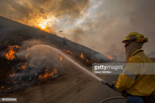 Firefighters use hoses and helicopters to fight the La Tuna Fire on September 2 2017 near Burbank California Los Angeles Mayor Eric Garcetti said at...