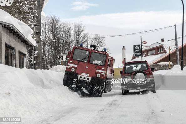 Firefighters vehicles in Campotosto Italy on January 19 2017 A great deal of snow has fallen in the area which was hit by four quakes on Wednesday...