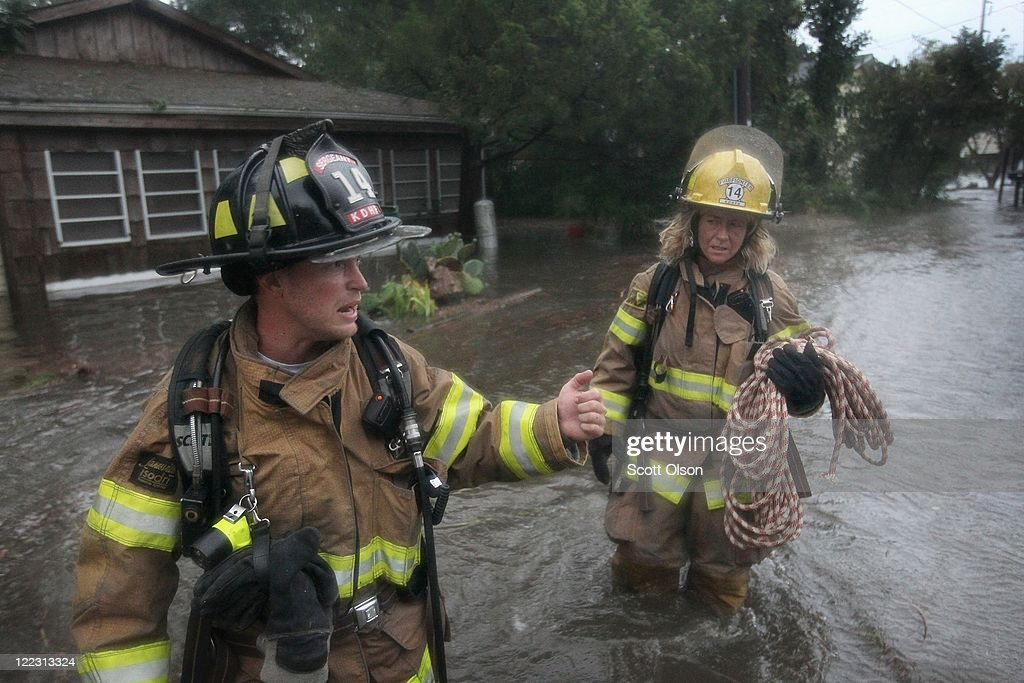 Firefighters wade through floodwater as they respond to a call of a gas leak during Hurricane Irene on August 27, 2011 in Kill Devil Hills, North Carolina. Hurricane Irene hit Dare County, which sits along the Outer Banks and includes the vacation towns of Nags Head, Kitty Hawk and Kill Devil Hills, as a category one hurricane around mid-day today causing wind damage and flooding.