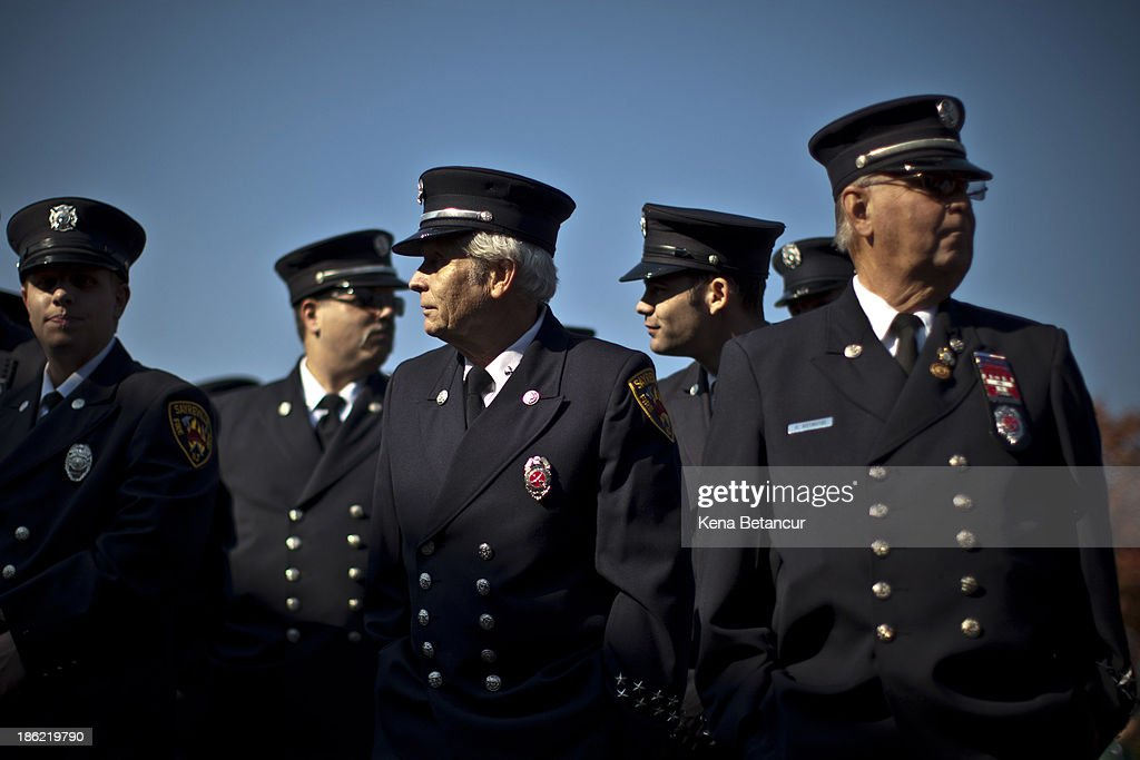 Firefighters wait for New Jersey Gov. Chris Christie to speak during a meeting with first responders at Sayreville Engine Company #1 on the anniversary of Superstorm Sandy on October 29, 2013 in Sayreville, New Jersey. Hurricane Sandy made landfall last year on October 29th near Brigantine, New Jersey and affected 24 states from Florida to Maine and cost the country an estimated $65 billion.