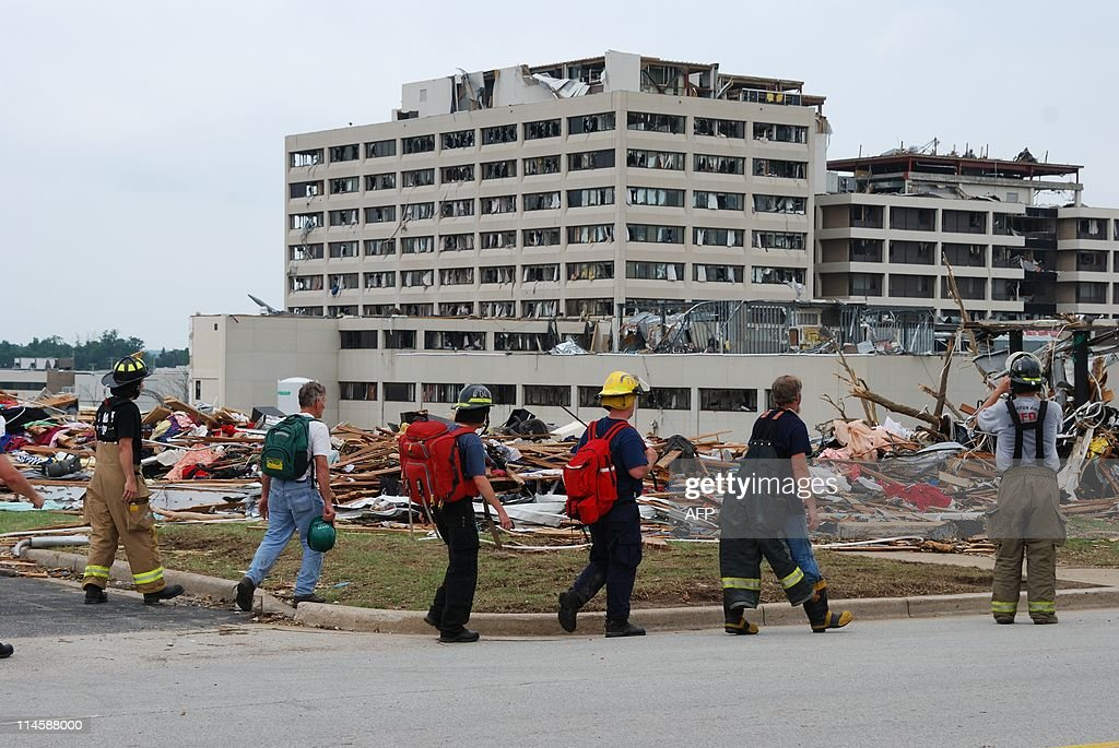 firefighters walk past the tornado ravaged st john 39 s hospital in pictures getty images. Black Bedroom Furniture Sets. Home Design Ideas