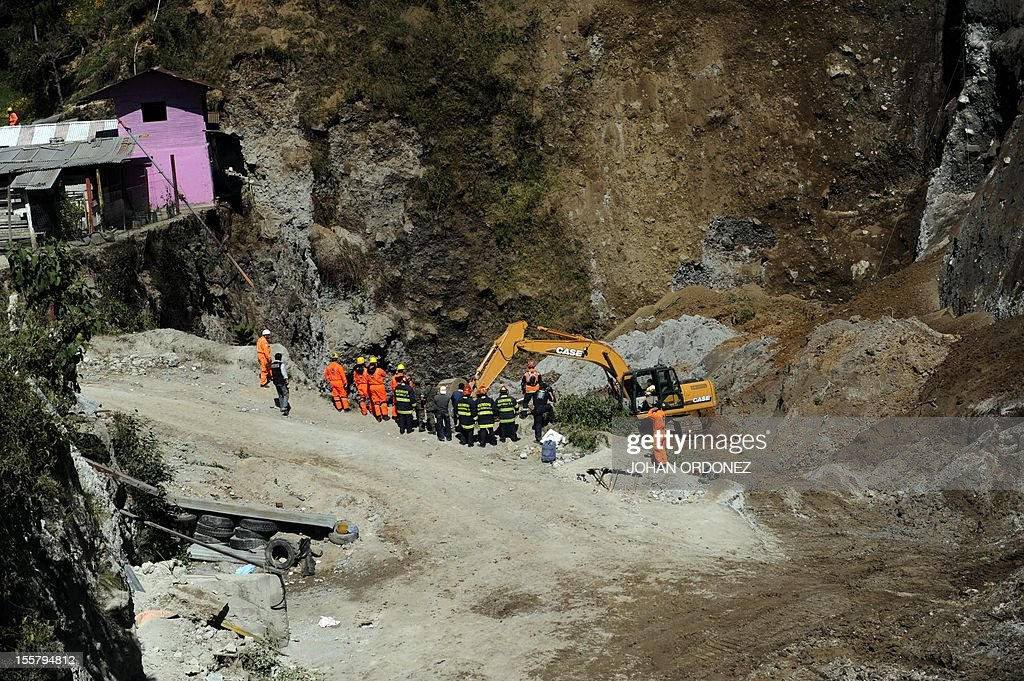 Firefighters with heavy equipment excavate searching people feared buried at a sand mine by an earthquake on the eve, in San Marcos, 260 km from Guatemala City, on November 8, 2012. A 7.4-magnitude earthquake rocked southwestern Guatemala on Wednesday, killing 48 people and injuring another 150 while more were missing as homes crumbled. The earthquake also rattled nerves in neighboring Mexico and El Salvador, sparking a tsunami alert on the Salvadoran coast and evacuations from offices, homes and schools as far north as Mexico City. AFP PHOTO/Johan ORDONEZ