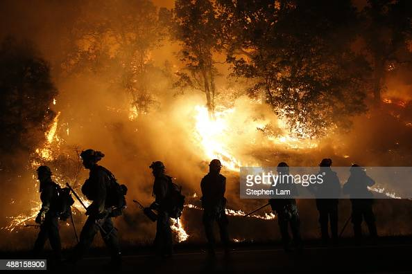 Firefighters with the Marin County Fire Department's Tamalpais Fire Crew monitor a backfire as they battle the Valley Fire on September 13 2015 near...