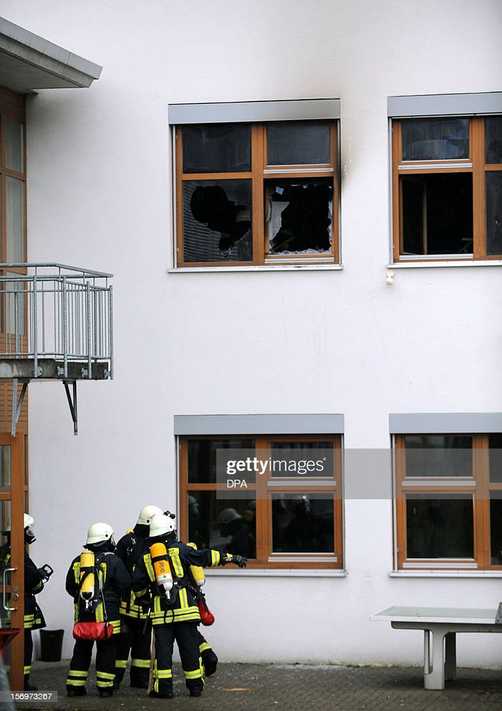 Firefighters work at the scene of a fire at a house with a workshop for handicapped people in Titisee- Neustadt, southern Germany on November 26, 2012. Fourteen people died after a fire broke out.