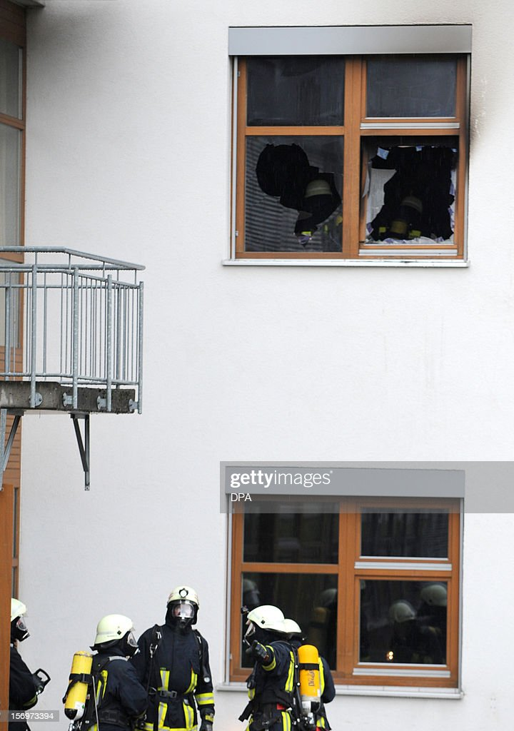 Firefighters work at the scene of a fire at a house with a workshop for handicapped people in Titisee- Neustadt, southern Germany on November 26, 2012. Fourteen people died after a fire broke out. AFP PHOTO / PATRICK SEEGER GERMANY OUT