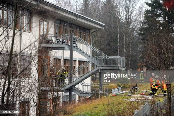 Firefighters work at the scene of a fire at a house with a workshop for handicapped people in Titisee Neustadt southern Germany on November 26 2012...