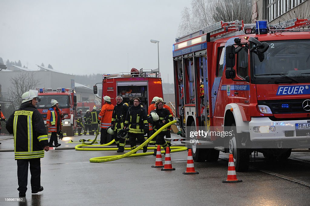 Firefighters work at the scene of a fire at a workshop for handicapped people in Titisee- Neustadt, southern Germany on November 26, 2012. Fourteen people died after a fire broke out.
