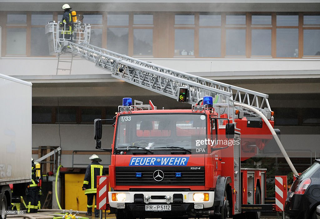 Firefighters work at the scene of a fire at a workshop for handicapped people in Titisee- Neustadt, southern Germany on November 26, 2012. Fourteen people died after a fire broke out. AFP PHOTO / PATRICK SEEGER GERMANY OUT