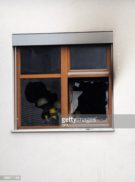 Firefighters work at the scene of a fire at a workshop for handicapped people in Titisee Neustadt southern Germany on November 26 2012 Fourteen...