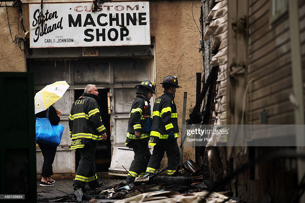 Firefighters work at the scene of a fivealarm fire that burned for several hours on June 5 2014 in the Staten Island borough of New York City The...