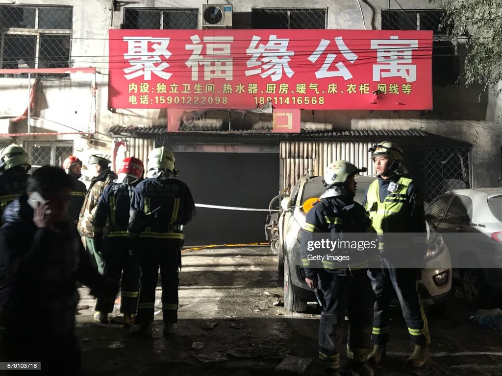 Firefighters work at the site after a house fire at Daxing District on November 19, 2017 in Beijing, China. Nineteen people were killed and eight others were injured in a house fire at Daxing District on Saturday night in Beijing.