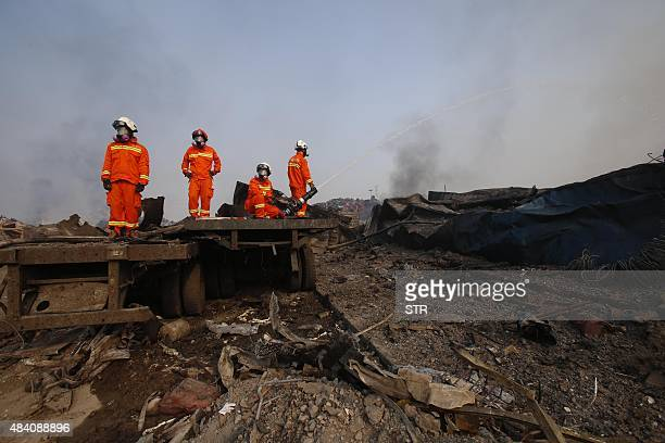 Firefighters work at the site of the explosions in Tianjin on August 15 2015 Residents near the site of two giant explosions in the northern Chinese...