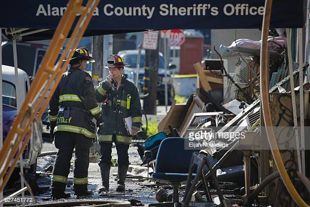 Firefighters work on the scene following an overnight fire that claimed the lives of at least nine people at a warehouse in the Fruitvale...