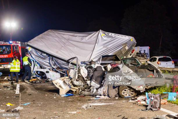 Firefighters work on the site of an accident on September 23 2017 on the motorway A67 near Ruesselsheim western Germany where a wrongway driver...
