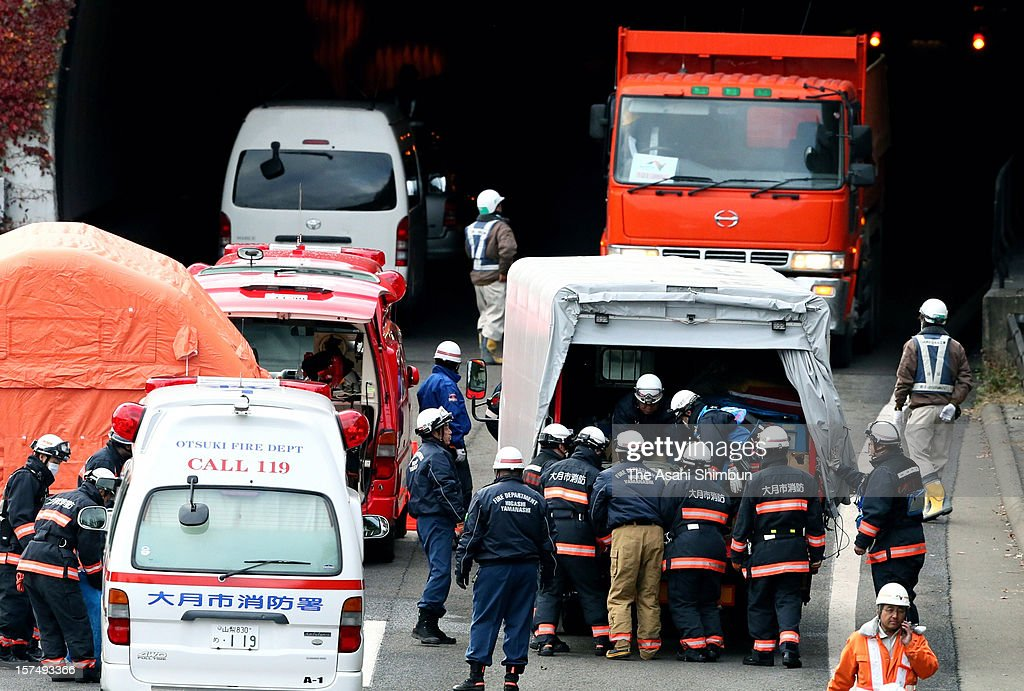 Firefighters work outside of Sasago Tunnel of the Chuo expressway on December 3, 2012 in Otsuki, Yamanashi, Japan. The concrete ceiling panels of the tunnel collapsed 130 metres and 9 people confirmed dead.