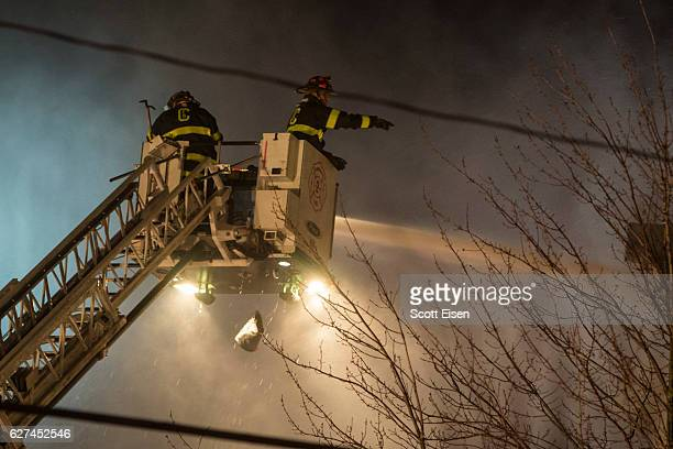 Firefighters work to contain a 10alarm fire near Berkshire St on December 3 2016 in Cambridge Massachusetts According to reports the fire has spread...