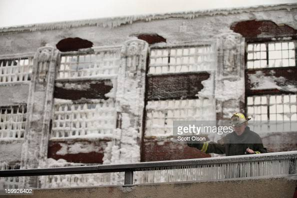 Firefighters work to extinguish a massive blaze at a vacant warehouse on January 23 2013 in Chicago Illinois More than 200 firefighters battled a...
