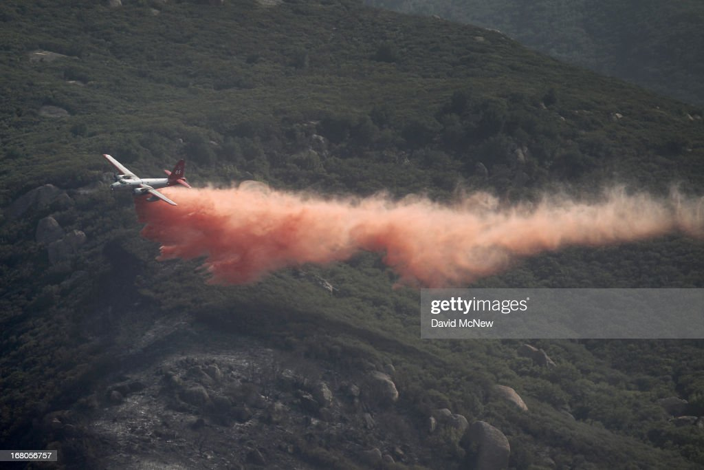 A firefighting air tanker plane drops fire retardant in Hidden Valley at the Springs fire on May 4, 2013 near Camarillo, California. Improving weather conditions are helping firefighters get the upper hand on the wildfire which has grown to 28,000 acres and is now 56 percent contained.