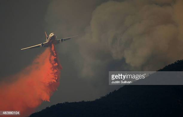 DC10 firefighting aircraft drops fire retardant on a ridge in front of the Rocky Fire on August 3 2015 near Clearlake California Nearly 3000...
