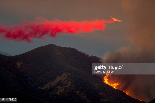 TOPSHOT A firefighting BAe146s jet drops fire retardant June 18 2016 at the Sherpa Fire near Santa Barbara California The socalled Sherpa fire in the...