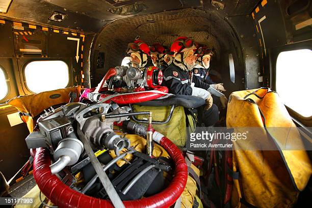 Firefighting Commandos of the Intervention Helicopter Detachment from the Bouches du Rhone travel in a helicopter to tackle a fire on June 192011 in...