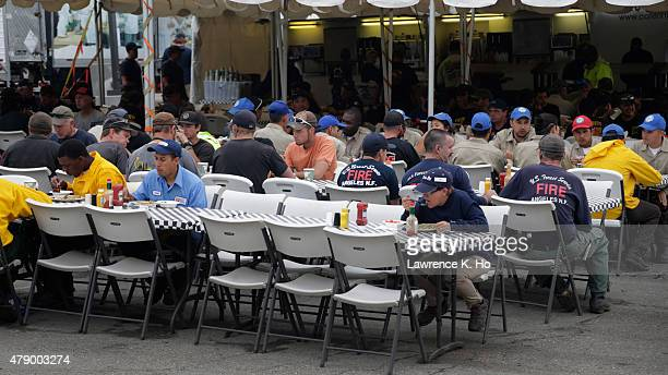 Firefighting crew and personnel eat at the mess hall at the base camp at Big Bear High Schools in on June 28 2015 in Big Bear California The US...