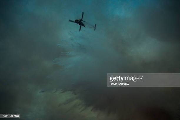 A firefighting helicopter drops water in the evening at the La Tuna Fire on September 2 2017 near Burbank California Los Angeles Mayor Eric Garcetti...