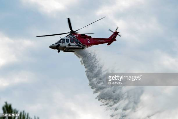 A firefighting helicopter making a water drop during the La Tuna fire in Los Angeles California On September 3 2017 Over 1000 firefighters battled...