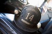 Firefighting helmet in fire engine on seat (selective focus)