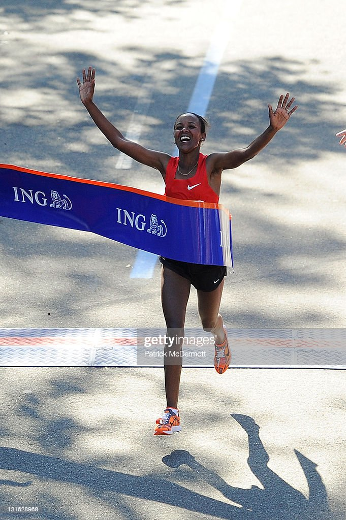 Firehiwot Dado of Ethiopia celebrates as she wins the Women's Division of the 42nd ING New York City Marathon in Central Park on November 6, 2011 in New York City.