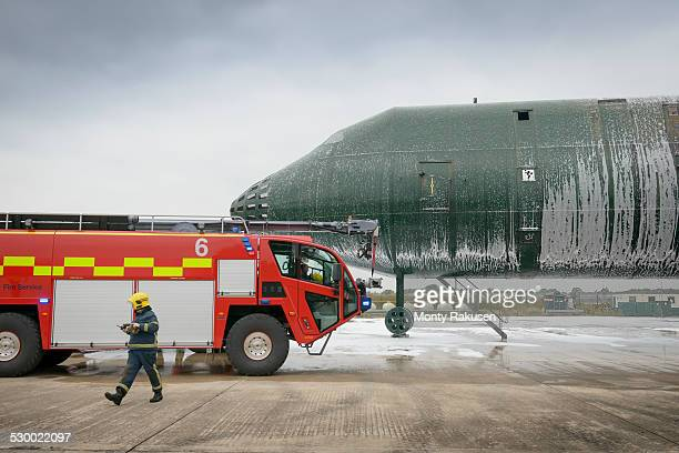 Fireman and fire engine at airport training facility