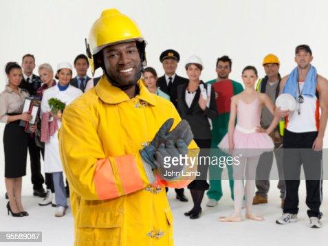 Fireman and modern community : Stock Photo