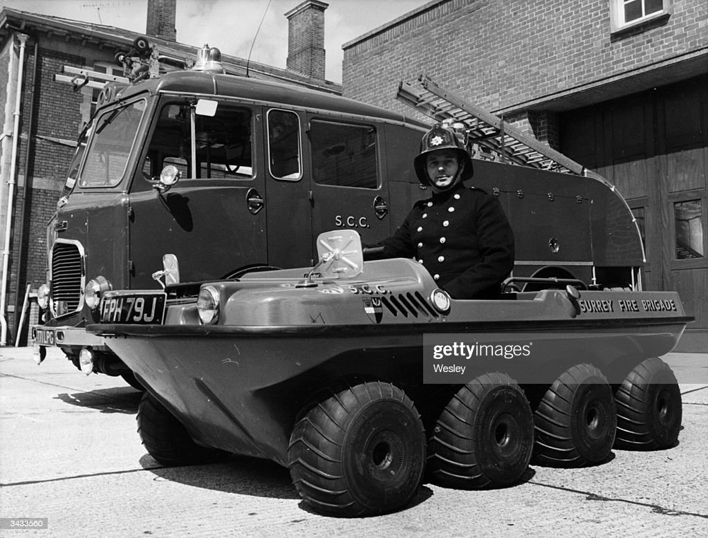 Fireman Bainbridge in the argocat at Reigate fire station Surrey The new vehicle has been designed by a company in Canada where it is used for...